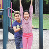 John P. Cleary | The Herald Bulletin<br /> Jojo Chandler, 11, pushes his sister, Hana Chandler, 9, on the playground equipment at Shadyside Park while they visited the park Saturday. The Chandlers live in Fishers and were in town visiting relatives over the holiday weekend.