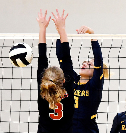 John P. Cleary | The Herald Bulletin<br /> Shenandoah's Kenedi Helms, right, dumps the ball over the net just past the defender in this JV match against Wapahani.