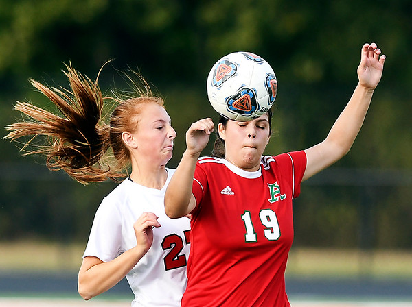 John P. Cleary | The Herald Bulletin<br /> Richmond's Hannah Trotter and Anderson's Silvia Rodriguez-Busby try for a header as they go after the ball.