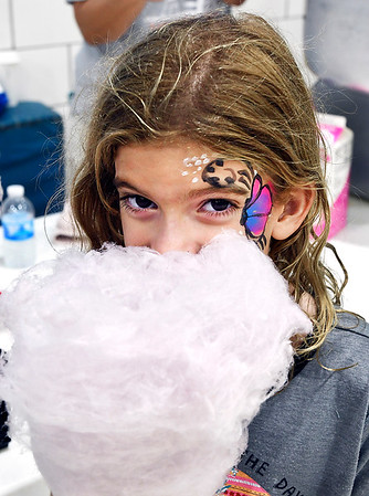 John P. Cleary | The Herald Bulletin<br /> Myla Harrison, 7, gets her face into the large cone of cotton candy as she attempts to eat it during the Madison County Solidarity Labor Council & United Auto Workers Building Committee Labor Day picnic Monday.