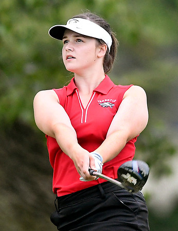 John P. Cleary   The Herald Bulletin<br /> Ellie Anderson, of Alexandria, watches her drive on the ninth hole at Elwood Golf Links.