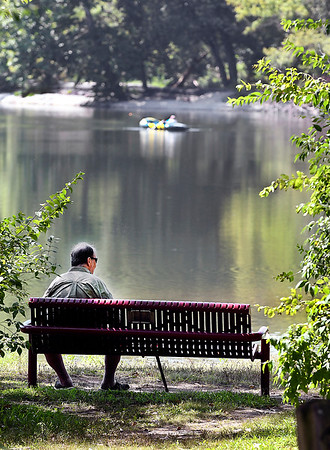 John P. Cleary | The Herald Bulletin<br /> A shady bench, a cool breeze, and a nice view over the water was a good way to spend part of warm afternoon at Shadyside Park for this gentleman.