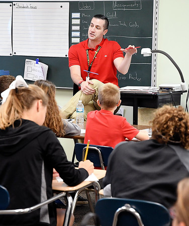 John P. Cleary | The Herald Bulletin<br /> Daleville Elementary School Language Arts teacher Aaron Parkison leads a discussion with his sixth-grade students.