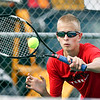 Frankton's Braxton Walls hits the ball over the net as he played the No. 2 singles match against Shenandoah's Luke Waggener.