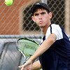 Shenandoah's No. 1 singles player, Lance Holdren, watches the ball during his match against Frankton's Logan Smith.