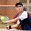 Shenandoah's No. 1 singles player, Lance Holdren, eyes the ball as he prepares to hit a forehand.