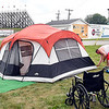 Joe Sowle, from Jackson, MI., tightens the ropes on the family tent as Melissa Ward looks on as they setup their campsite right outside the pit gate of Anderson Speedway Tuesday afternoon. Campers have been moving into the grounds this week in preparation for all the on track activity starting Wednesday leading up to the running of the Little 500 Saturday night.