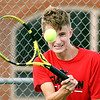 Frankton's No.1 singles player, Logan Smith, grits his teeth as he hits a forehand shot during his match against Shenandoah's Lance Holdren.