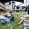 Old friends meet up again at Anderson Speedway as Dale Fearneyhough of Springfield, Ill., Paul Price of Anderson, and John Atchison of Grand Rapids, MI., sit outside their motor homes Tuesday afternoon and catch up with one another during their annual trek to Anderson for the Little 500 sprint car race.