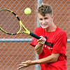 Frankton's No.1 singles player, Logan Smith, hits a forehand to his opponent during their match against Shenandoah Monday evening.