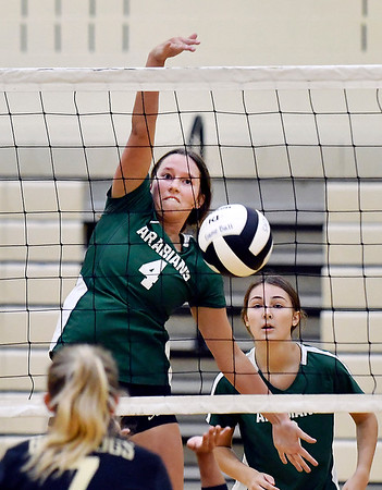 """Pendleton's Hannah Grile gets a """"slam dunk"""" kill straight down over the net for a point."""