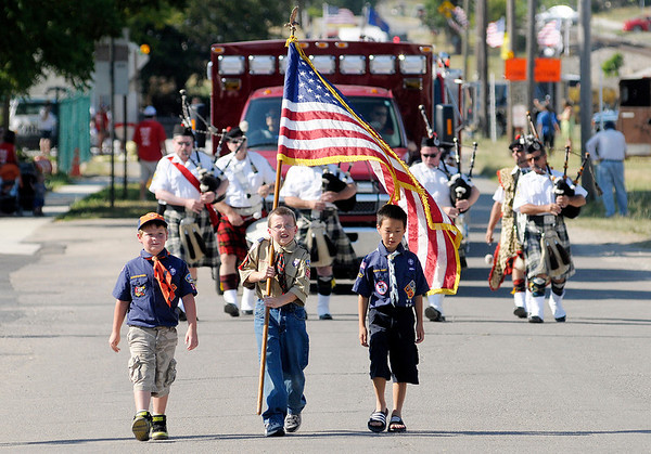 Boy Scouts lead the parade to kick off the 3rd Annual Summitville Country Fair on Wednesday. The fair runs through the 30th.
