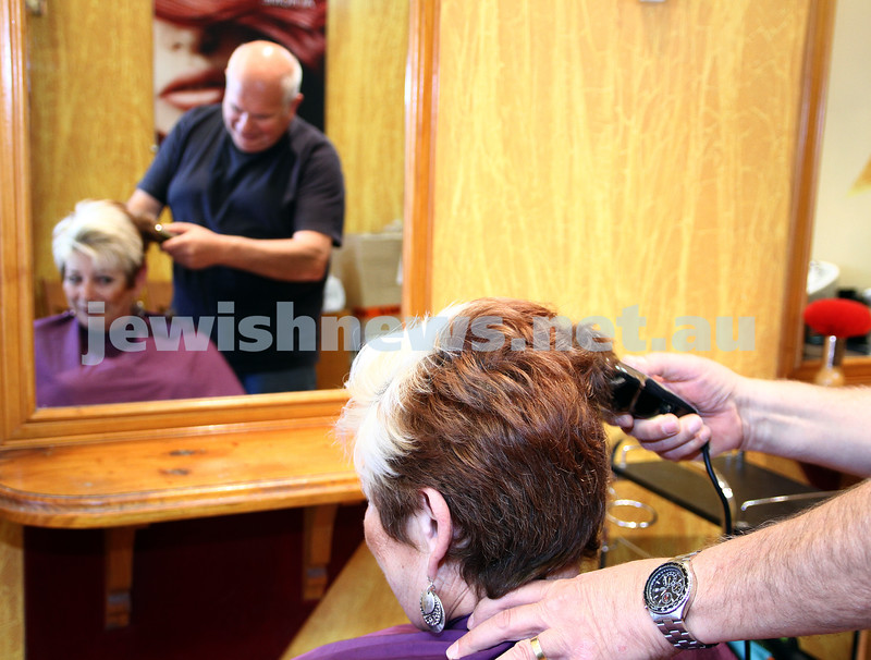 "7-3-12. Betty Kranz having her head shaved by husband Issy to raise money for the annual ""Shave for a cause"". Photo: Peter Haskin"