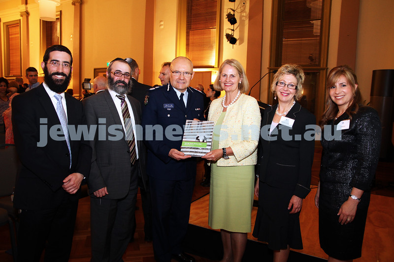 """15-11-11. Jewish Taskforce Against Famiy Violence. Book lanuch with the Rabbinical Council of Victoria, """" Will my Rabbi Believe me? Will he understand?"""". From left: Rabbi Yaakov Glasman, Rabbi Meyer Kluwgant, Cheif Commissioner Ken lay, Andrea Coote, Deborah Weiner, Sheiny New. Photo: Peter Haskin"""