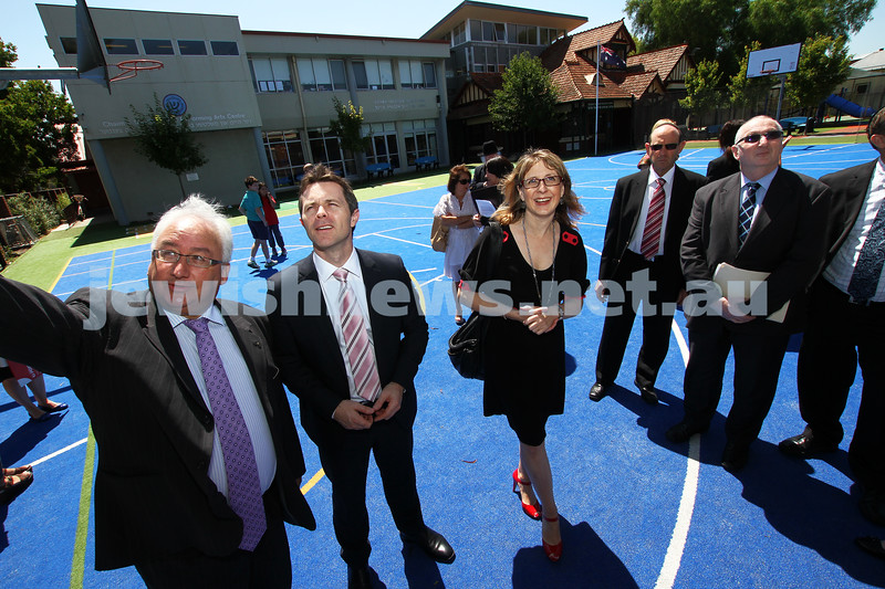 22-2-12. Michael Danby (left) pointing out some of the new security up grades at Sholem Aleichem College to the Minister of Home Affairs, Jason Claire (second from left). Photo: Peter Haskin