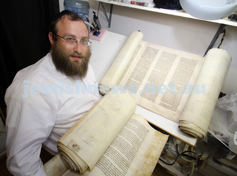 Old sefer torah from Hobart. Rabbi Eli Gutnick with the  scrolls from Hobart that require restoration. Photo: Peter Haskin