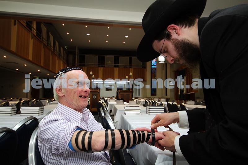 5-9-10. Jewish Care Disability Services. Rosh Hashanah service and kiddush at Malvern Chabad. David Fajgenbaum laying tephillin. Photo: Peter Haskin