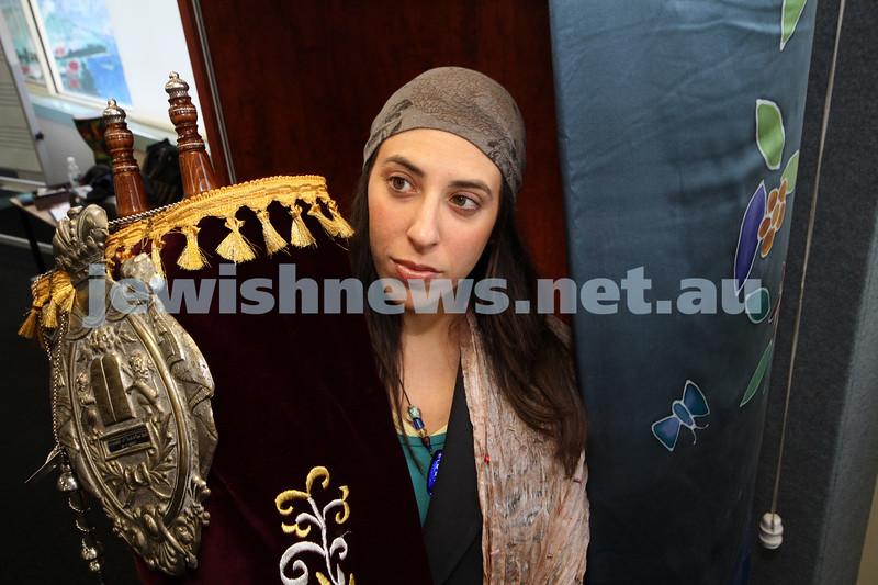6-9-10. Rabbi Gabbi Sar-Shalom holds a torah at the Kedem synagogue. Photo: Peter Haskin