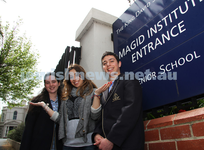 5-10-10. Yelena Kogan (centre) a member of The King David School's first VCE graduation class in 2000 with 2010 VCE students Amit Witkin and Bryan Ladowsky. Photo: Peter Haskin