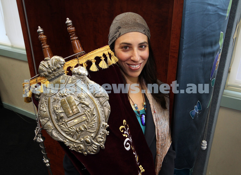 6-9-10. Rabbi Gabbi Sar-Shalom holds a torah at the Kedem synagogue. Photo: Peter Haskin