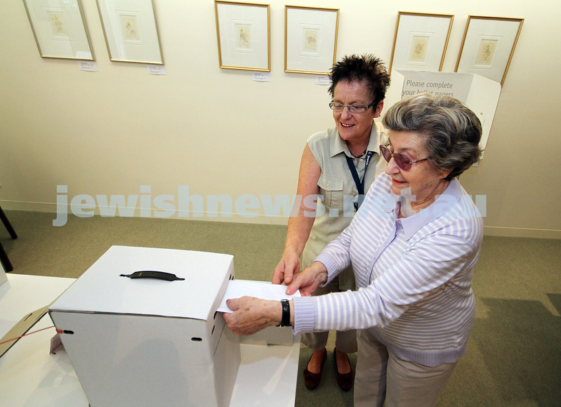 23-11-10. Gary Smorgon House resident Esther Korman, assisted by Glenda Johnson, casts her vote for the upcoming State election. Phoo: Peter Haskin