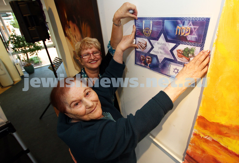 Preparing for Pesach at Emmy Monash.Resident Chana Urbinder putting up decorations with Emmy assistant Miriam Greenhill. Photo: Peter Haskin
