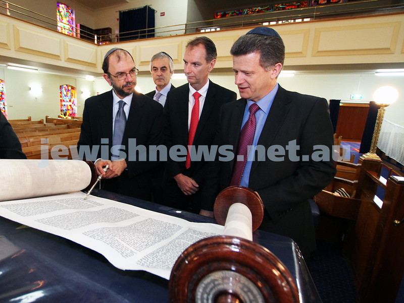 10-8-11. Victorian Minister for Multicultural Affairs and Citizenship Nicolas Kotsaris visits Caulfield Shul. Rabbi Ralph Genende showing the minister one of the shul's sefer torah. From left: Rabbi Ralph Genende, Rodney Horin, David Southwick, Nicolas Kotsaris.  Photo: Peter Haskin