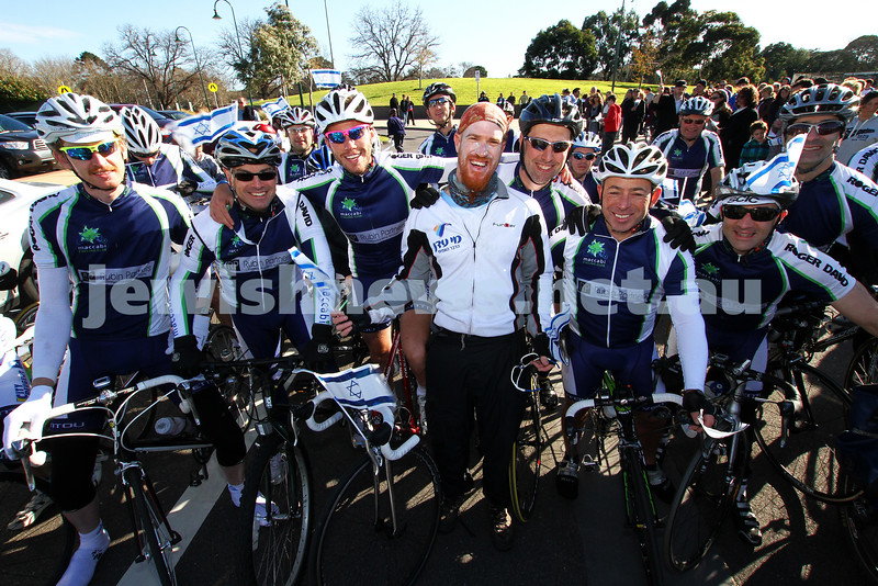 "26-6-11. Memebers of the Maccabi Cycling Club, led by Israeli around the world cyclist Roei ""Jinji"" Sadan (centre) arrive at Caulfield park for a solidarity rally to mark 5 years of Gilad Shalit's captivity. Photo: Peter Haskin"
