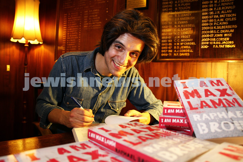 29-6-11. Raphael Brous signing copies of his book at it's launch at the Kelvin Club in Melbourne. Photo: Peter Haskin