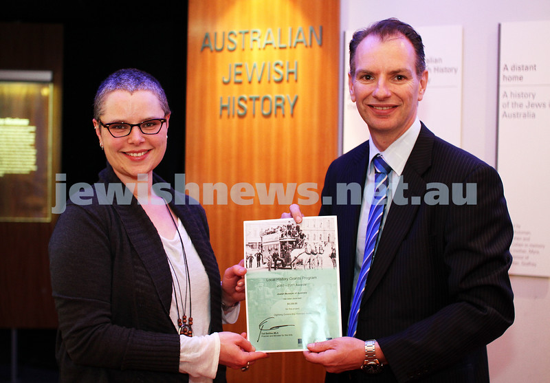 """26-9-11. Member for Caulfield David Southwick with Jewish Museum of Australia Director Rebecca Forgasz. Handing over a certificate for a grant under the Local History Grants Program from the State government. The grant is for """"Digitising Dunera Boys histories audio"""". Photo: Peter Haskin"""