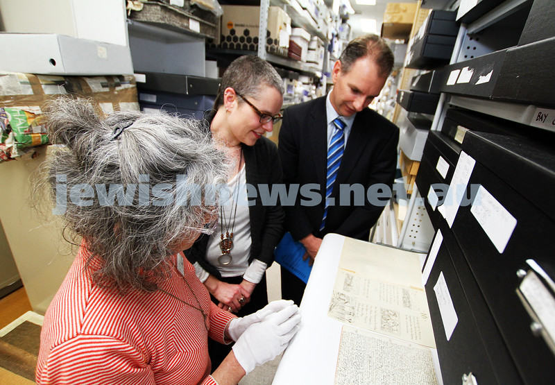 26-9-11. Member for Caulfield David Southwick with Jewish Museum of Australia Director Rebecca Forgasz (centre) and Collections curator Susan Faine, being shown some of the archived pieces for the museum's Dunera and internment collection. Photo: Peter Haskin