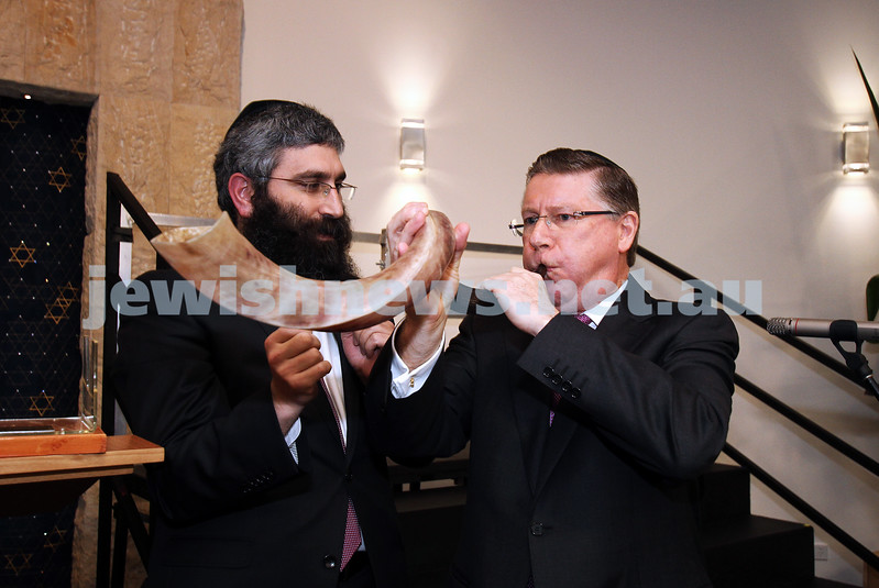 12-8-13. Hamerkaz Centre. Victorian Premier Dr Denis Napthine visits the new Centre to officially open the Lamdeni School. The Premier attempts to blow the shofar with Rabbi Motty Liberow. Photo: Peter Haskin