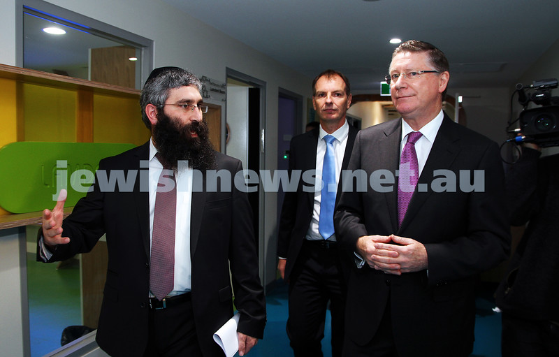 12-8-13. Hamerkaz Centre. Victorian Premier Dr Denis Napthine visits the new Centre to officially open the Lamdini School. Rabbi Motty Liberow takes the Premier on a tour of the new facilities. Photo: Peter Haskin