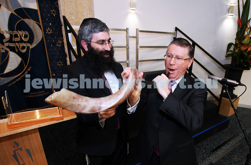 12-8-13. Hamerkaz Centre. Victorian Premier Dr Denis Napthine visits the new Centre to officially open the Lamdeni School. The Premier attempts to blow the shofar with Rabbi Motty Liberow Photo: Peter Haskin