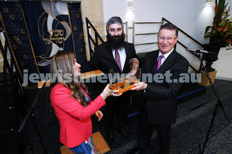 12-8-13. Hamerkaz Centre. Victorian Premier Dr Denis Napthine visits the new Centre to officially open the Lamdeni School. Dina and Rabbi Motty Liberow present the Premier with a shofar. Photo: Peter Haskin