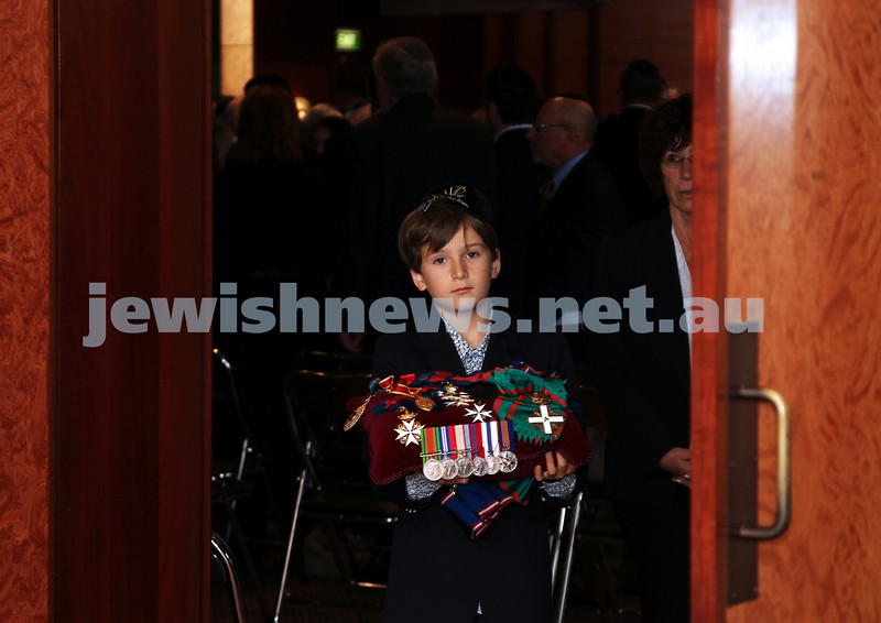 13-12-11. Memeorial service for former Australian Governer General, Sir Zelman Cowen. Held at Temple Beth Israel, Alma Rd., East St Kilda. Mitch Cowen, Grandson of Sir Zelman leads the coffin out carrying his grand father's medals. Photo copyright: AJN/Peter Haskin.