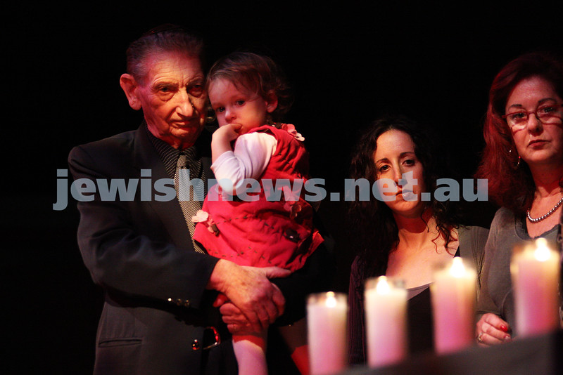 Yom Hashoa 2011. Survivor Peter Steiner holding his grand daughter Emma Steiner. Natalie Ovadia (centre) and Sue Gorn look on.  Holocaust rememberance ceremony, Robert Blackwood Hall, Monash University. Photo: Peter Haskin