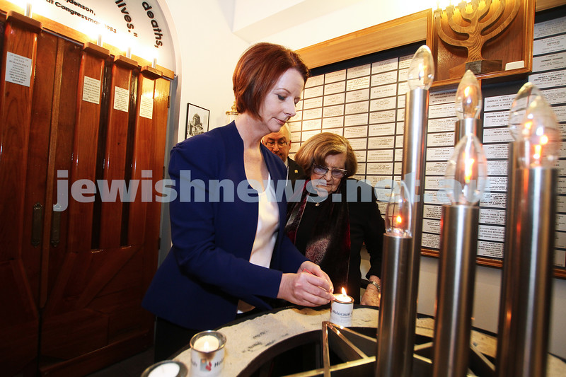 26-7-12. Australian Prime Minister Julia Gillard lights a memorial candle with Survivor Kitty Altman at the Jewish Holocaust Museum in Melbourne. Photo: Peter Haskin