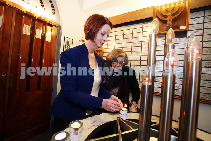 26-7-12. Australian Prime Minister Julia Gillard lights a memorial candle with Survivor Kitia Altman at the Jewish Holocaust Museum in Melbourne. Photo: Peter Haskin