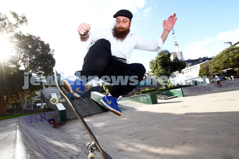 6-6-12. Rabbi and avid skate boader Dovid Tsap taking time out to practice a few moves at the Prahran skate park in Melbourne. Photo: Peter Haskin
