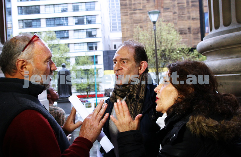 """16-9-13. State Library of Victoria. Lecture by Richard Falk on """" Human Rights in the Occupied Palestinian Territories"""". David Shulberg (centre) and Rachel Merhav discuss Middel East poitics with a member of the public on the steps of the State Library. Photo: Peter Haskin"""