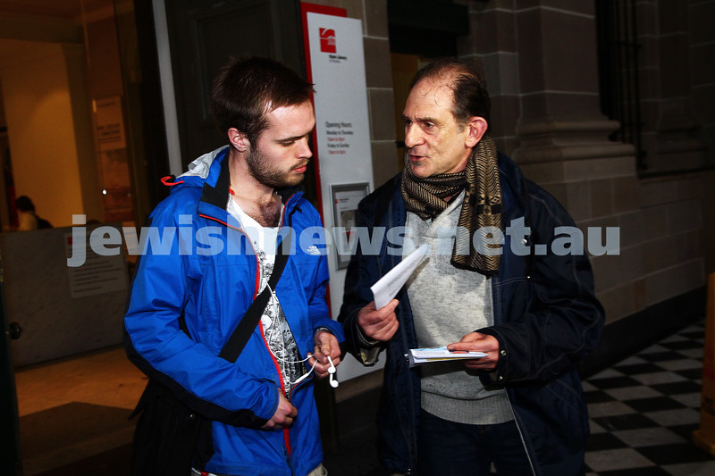 """16-9-13. State Library of Victoria. Lecture by Richard Falk on """" Human Rights in the Occupied Palestinian Territories"""". David Shulberg (right) discusses Middel East poitics with a member of the public on the steps of the State Library. Photo: Peter Haskin"""