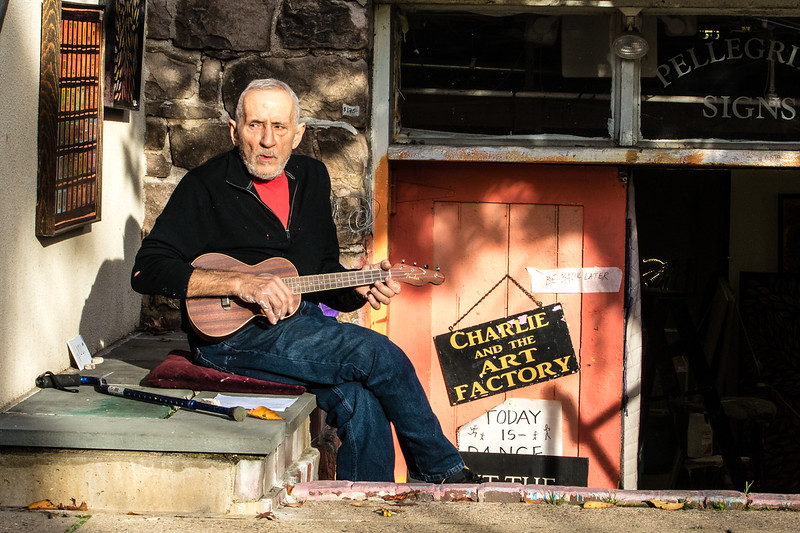 Painter and sign maker Charles Pellegrino, relaxes and plays his Ukukele outside his studio at 204 North Union St. in Lambertville, New Jersey on October 31, 2016.  ( TONI FARINA / Staff Photographer )