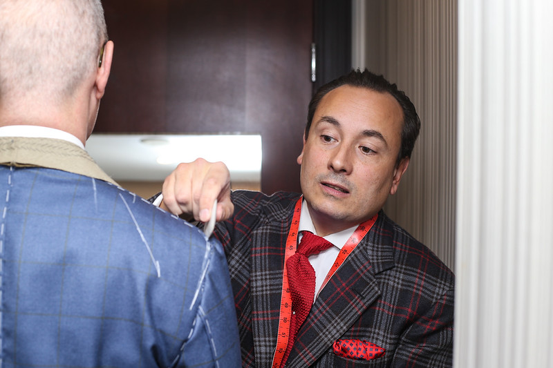 Savile Row master tailor Steven Hitchcock (left) taking measurements of local wedding photographer Patrick Snook's $4500 bespoke suit on October 13, 2016 at the Sofitel Hotel on 120 S. 17th Street in Philadelphia, Pa.  ( TONI FARINA / Staff Photographer )