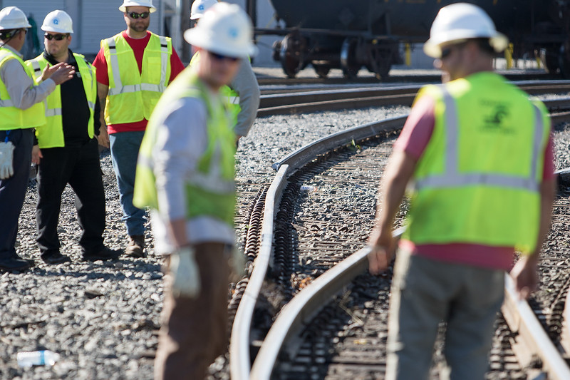 CSX train yard workers discuss train derailment at Penn Line Road and West Jefferson Streets on October 11, 2016, in Paulsboro, New Jersey. ( TONI FARINA / Staff Photographer )