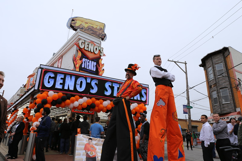 Geno's Steaks celebrates its 50th Anniversary with a free celebration on Saturday October 1, 2016, with Stiltwalkers Dale Varga and Doug Young at 1219 South 9th Street in Philadelphia ( TONIFARINA / Staff Photographer )
