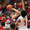 Silver Creek guard Grant Meyer draws a foul from Jeffersonville forward Bryce roland in a 72-60 loss to the Red Devils Friday night.  staff photo by C.E. Branham