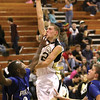 Henryville post player Brad Everage puts up a shot against Charlestown Tuesday night.  Staff photo by C.E. branham