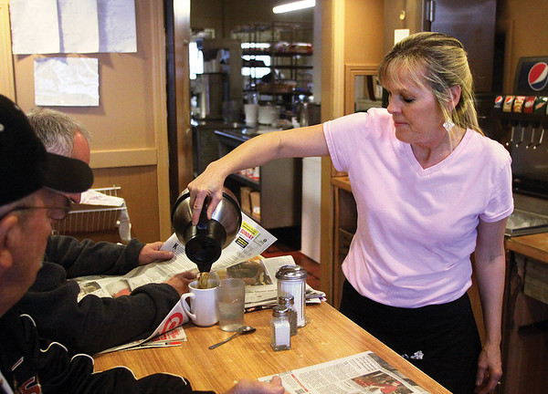 Server Vicki Jordan pours a cup of coffee at Jerry's Restaurant in Jeffersonville.  Staff photo by C.E. Branham
