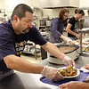 Kenny Dunn trays a turkey dinner with all the trimmings at the Community Kitchen in Jeffersonville.  The turkey served was donated by The Salvation Army for the Thanksgiving meal.  Staff photo by C.E. Branham